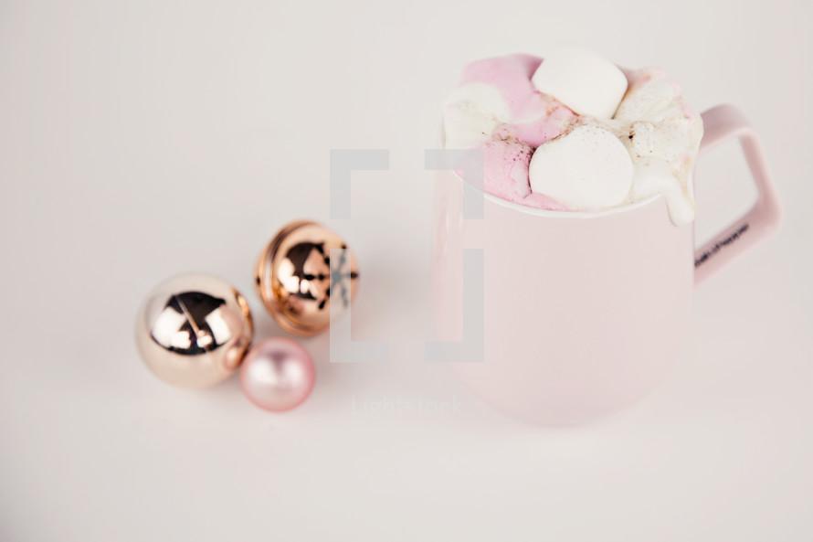 pink mug and Christmas ornaments