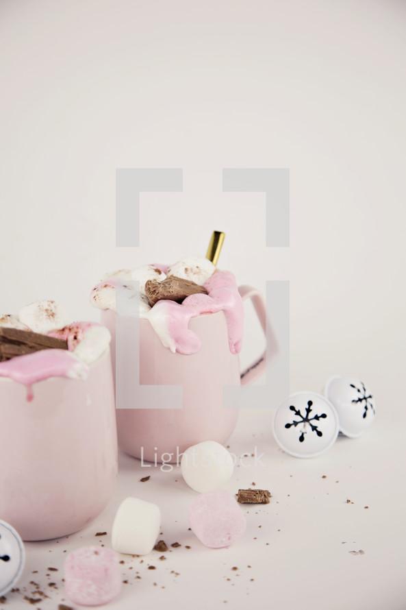 pink mugs and Christmas ornaments
