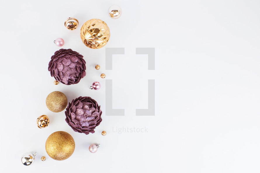silver, pink, purple, and gold Christmas ornaments on white