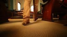 man walking into a church