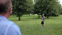 father and son throwing a baseball