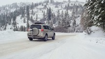 SUV driving on a snow covered road