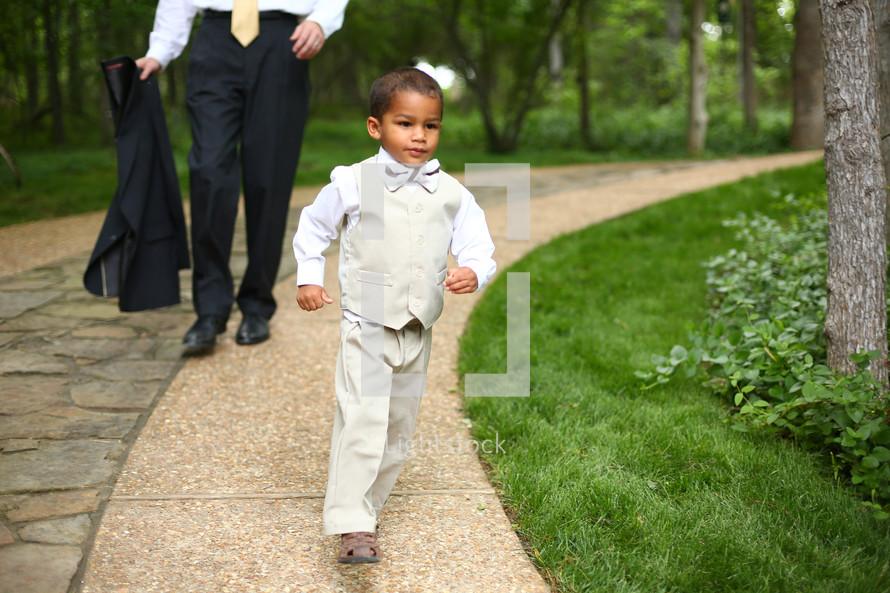 ring bearer running outdoors