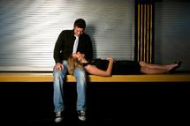 woman lying her head on a man's lap