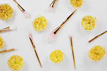 makeup brushes and yellow flowers