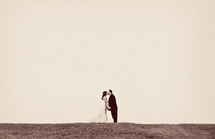 distant bride and groom kissing