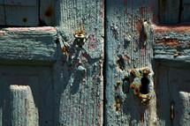 pealing aqua paint on an old wood door