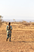 soldier carrying a gun in Africa
