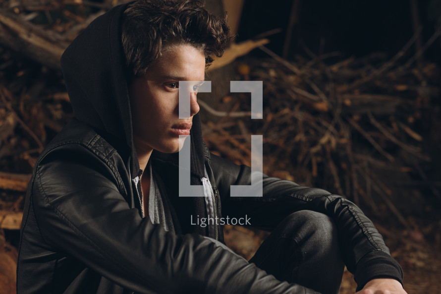 teen boy in a hoodie and leather jacket