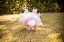 a baby in a diaper and tutu