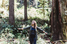 a woman praising God outdoors