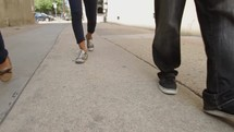 friends walking down an alley talking