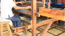 Weaving fabric on a traditional loom.
