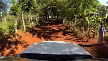 driving on a dirt road in the Dominican Republic