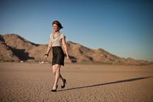 woman walking in heels on desert soil