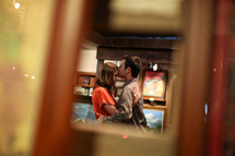 man kissing a woman's forehead