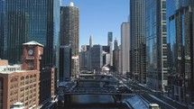 Aerial view of Downtown Chicago, The Magnificent Mile, Chicago River, and The Bean.