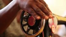 a woman on a sewing machine in Uganda
