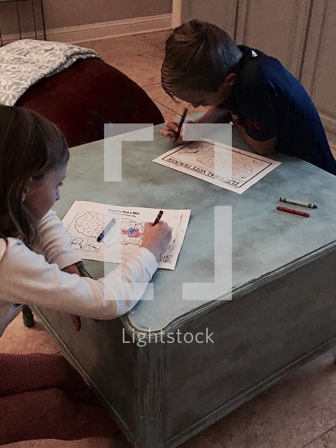 children watching election results on election night and coloring a political map of the United States red or blue