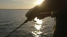 fisherman casting a fishing pole