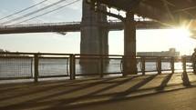Setting sun under Brooklyn Bridge