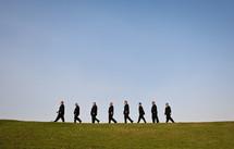 groomsmen walking in a line