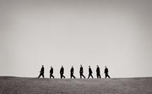 groomsmen walking in a line outdoors