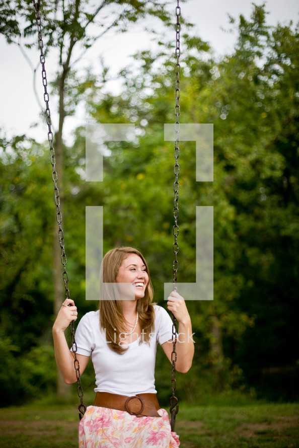 woman on a swing outdoors