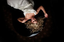 bride lying on carpet