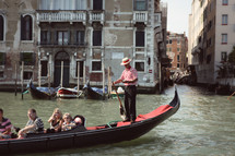 tourists on a gondola in Venice, Italy