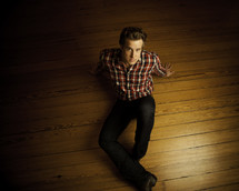 man sitting on a wood floor