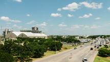 Timelapse of traffic surrounding a football stadium.