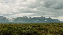 gray clouds over mountain peaks