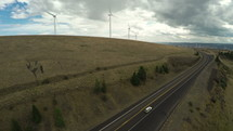 wind turbines at the top of a hill
