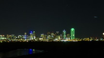 Timelapse of the downtown Dallas skyline at night.