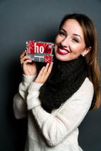 smiling teen girl holding a Christmas gift