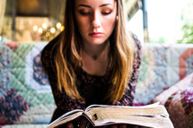 a teen girl reading a Bible