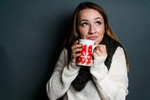 Young woman holding winter mug