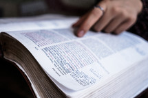 reading a Bible with notes in it