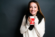 teen girl holding a mug with hot tea
