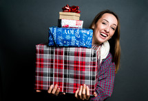 teen girl holding Christmas gifts