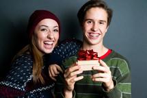 teens with a Christmas gift