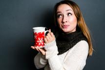 teen girl holding a mug of hot cocoa