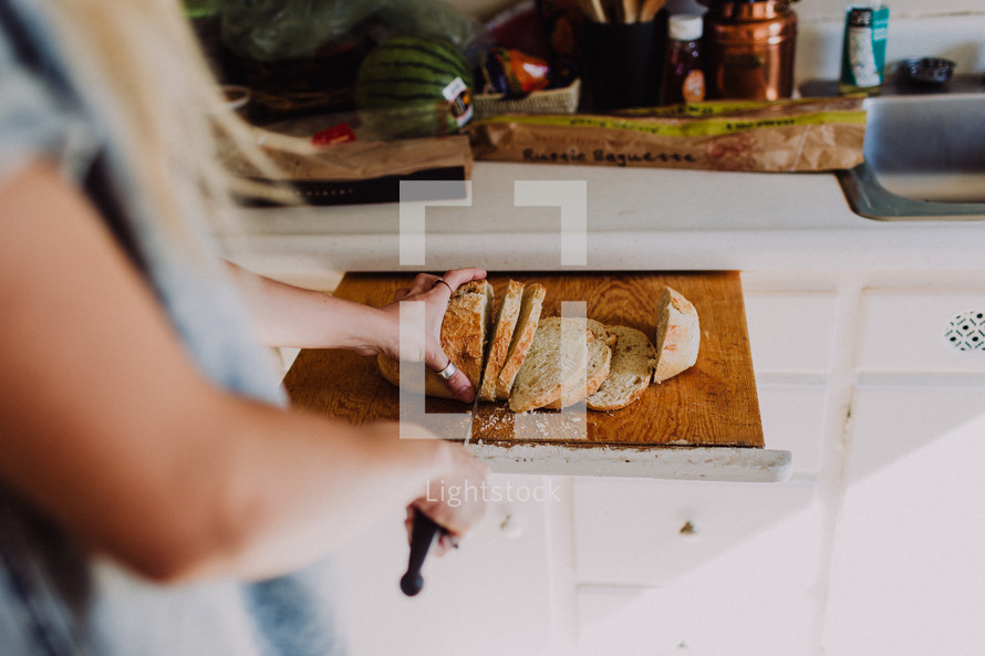 a woman slicing bread with a knife