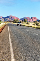 Jeep on a road through the Australian outback