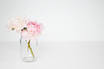 clear vase with pink flowers