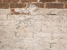 rough wall texture revealing brick