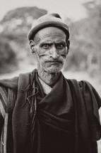 older man wearing a hat