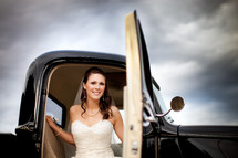 bride stepping out of an old truck
