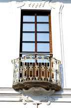 A tall window with an iron balcony.
